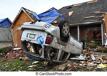 tornado destruction - House leveled and car flipped by a...