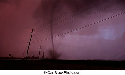 Tornado from a severe thunderstorm touches down near Taylor Ridge Illinois on December 23, 2015.