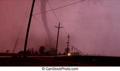 Tornado narrowly misses oncoming traffic near Taylor Ridge Illinois on December 23, 2015.