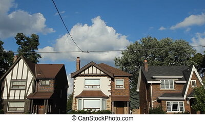 Toronto houses. Timelapse. - Three suburban houses in ...