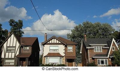 Three suburban houses in Toronto. Timelapse.