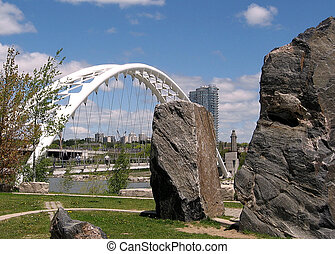 Humber Bay Arch Bridge and stones on bank of lake Ontario in Toronto, Canada