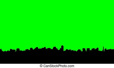 Long pan of a skyline silhouette of the city of Toronto, Ontario, Canada.