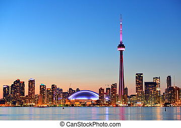 Toronto skyline - Toronto sunset over lake panorama with...