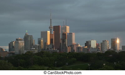 Toronto skyline sunset. Timelapse. - Timelapse of clouds and...
