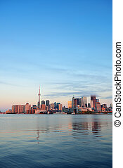 Toronto sunrise with sunlight reflection over lake in the ...