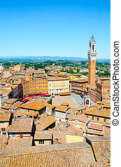 Torre del Mangia in ancient medieval historical centre of Siena