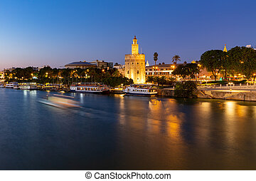 Torre del Oro at night at the Guadalquivir river in Seville...