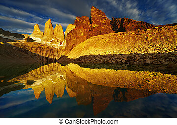 Torres del Paine at sunrise - Towers with reflection at ...