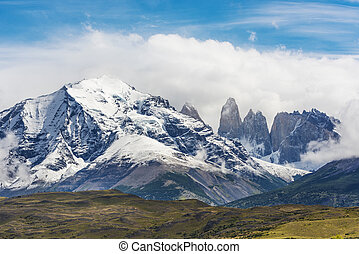 Torres del Paine peaks coming from clouds. Torres del Paine...