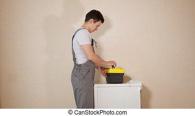 torsions, mur, réparateur, cassé, machine, vis, lavage
