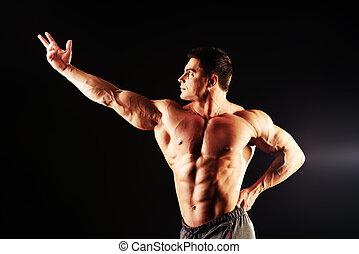 torso man - Handsome muscular bodybuilder posing over black ...