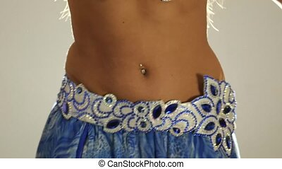 Torso of beautiful traditional oriental belly dancer shaking...