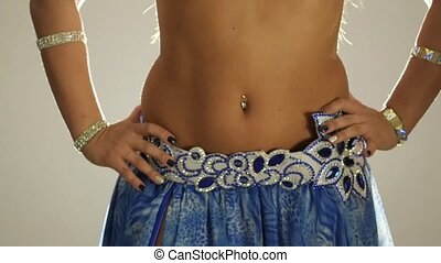 Torso of beautiful traditional oriental belly dancer shaking body slow motion