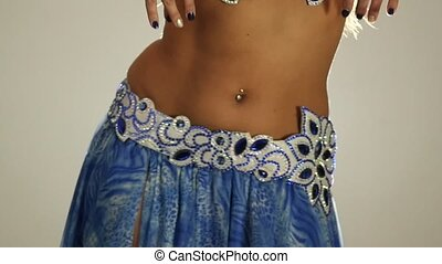 Torso of beautiful traditional oriental belly dancer shaking body. slow motion
