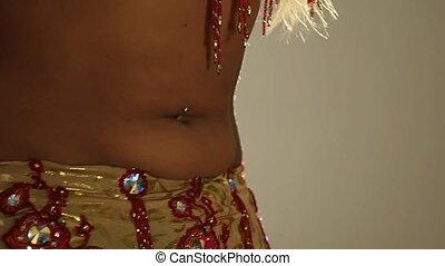 Torso of beautiful young arabian woman dancing oriental...