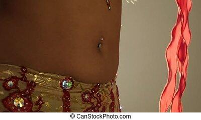 Torso of beautiful young arabian woman dancing oriental belly dance. slow motion