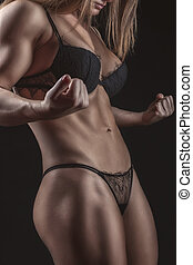 Torso sports girl bodybuilder with big muscles.