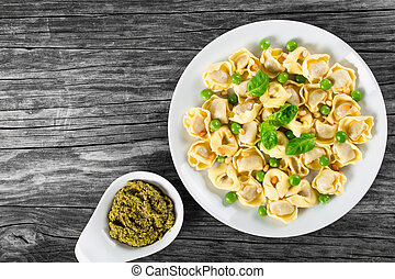 tortellini with green peas, fried Pine nuts,  top view