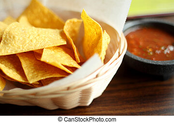 Tortilla chips and salsa in a bowl.