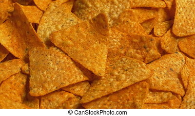 Bowl of tortilla chips turning slowly