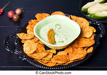 Tortilla chips with avocado dip on a plate - Tortilla chips...