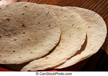 Tortilla shells - tortilla shells on a table ready for...