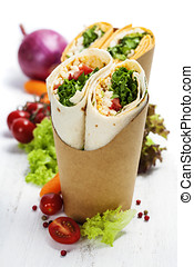 tortilla wraps with chicken and fresh vegetables isolated on...