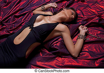Torture - Woman Hands In Chains On Red Satin