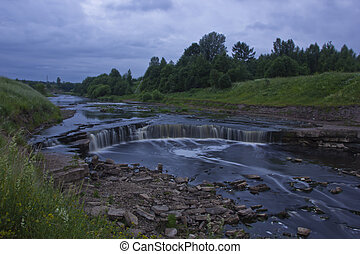 Tosno waterfall in the Leningrad region on a cloudy evening