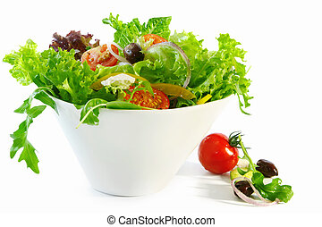 Tossed Salad - Tossed green salad in a white bowl. Mixed...