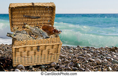 tossed trash overgrown with sea shells