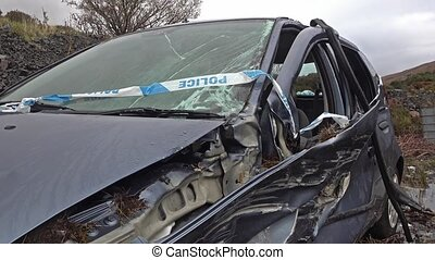 Total loss car with exploded airbag, windscreen and axle ...