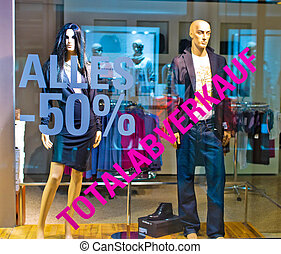total sales in clothing store - in a shop for clothing of...