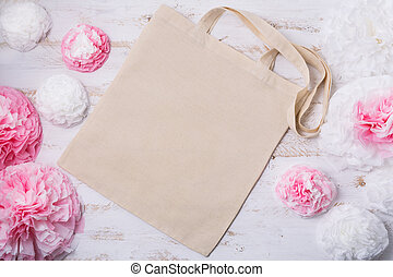 Canvas tote bag mockup with white and pink paper flowers. Empty tote bag mock up for branding presentation.