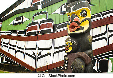Totem pole and Traditional House - Haida painting on side of...