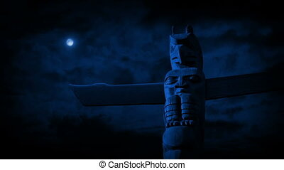 Totem Pole In The Moonlight - Tribal hand-carved totem pole...