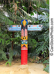 Totem poles and tropical plants