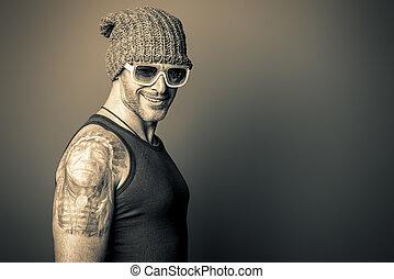 totem tattoo - Portrait of a handsome brutal man.