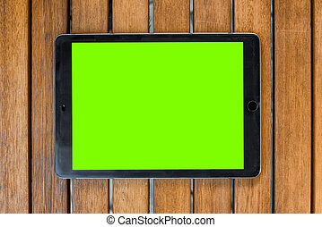 touch pad on a wooden background