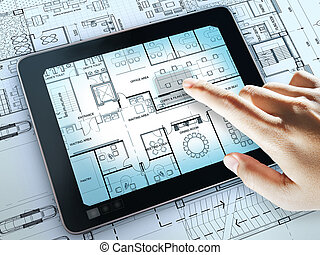 touch screen computer shows interior layout plan of office ...