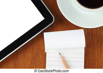Touch screen device, notepad, pencil and cup of coffee on wooden background close-up