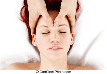 Touch therapy - woman getting a head massage by therapist