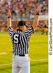 Touchdown - A Football Official signaling football and a...