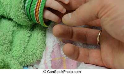 Touching Newborn Baby's Hands