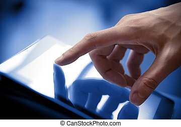 Touching Screen On Tablet PC - Man hand touching screen on...