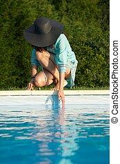 touching water on swimming pool