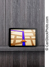 Touchpad gps on the wood shelf and wood wall