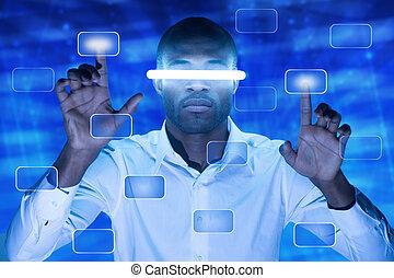 Touchscreen button - African American man pressing a...
