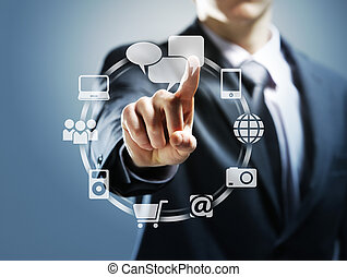 touchscreen interface - Businessman pressing virtual icons